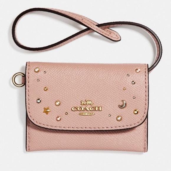 67e383a9232 Coach card pouch wristlet with celestial studs